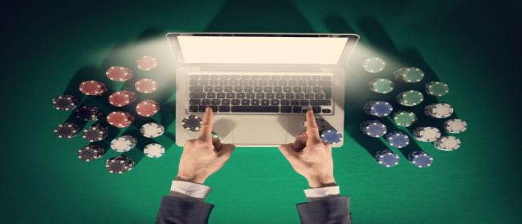 online gambling, betting chips and laptop